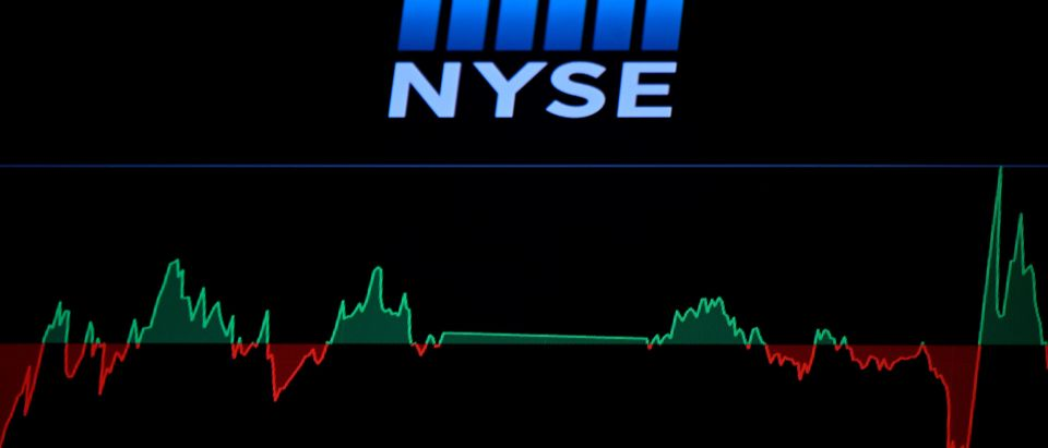 A screen shows a graph before the opening bell at the New York Stock Exchange (NYSE) on March 16, 2020 at Wall Street in New York City. - Trading on Wall Street was halted immediately after the opening bell Monday, as stocks posted steep losses following emergency moves by the Federal Reserve to try to avert a recession due to the coronavirus pandemic.Just after the opening bell, the S&P 500 was at 2,490.47, a drop of 8.1 percent and beyond the seven percent loss that automatically triggers a 15-minute trading halt. (Photo by Johannes EISELE / AFP) (Photo by JOHANNES EISELE/AFP via Getty Images)