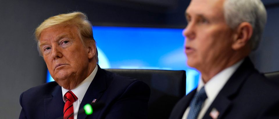 President Donald Trump listens as Vice President Mike Pence speaks during a teleconference with governors at the Federal Emergency Management Agency headquarters,on March 19, 2020 in Washington, DC. (Evan Vucci-Pool/Getty Images)