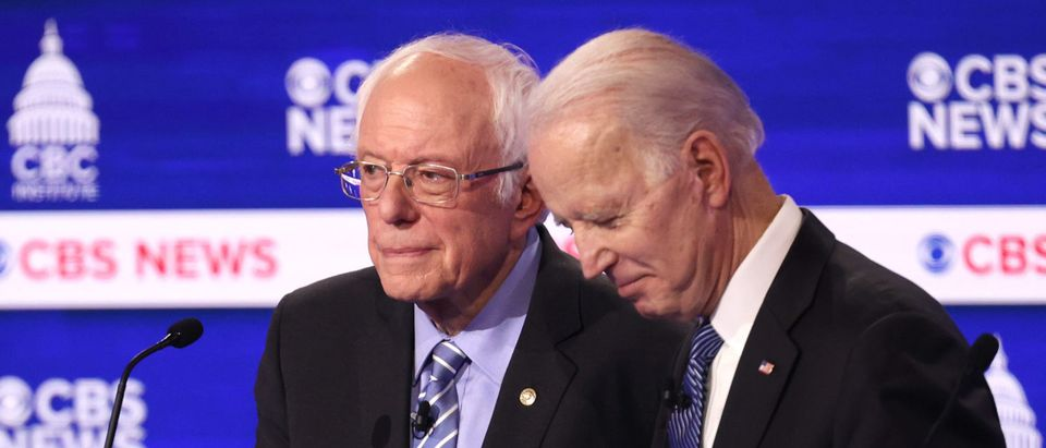 Democratic presidential candidates Sen. Bernie Sanders (I-VT) and former Vice President Joe Biden speak during a break at the Democratic presidential primary debate at the Charleston Gaillard Center on February 25, 2020 in Charleston, South Carolina. (Win McNamee/Getty Images)