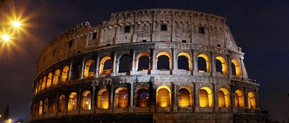 The ancient Roman Colosseum is illuminat