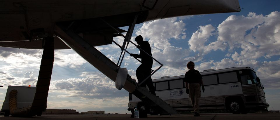 A Guatemalan illegal immigrant boards a plane at a flight operation unit at Mesa airport during his deportation process in Phoenix