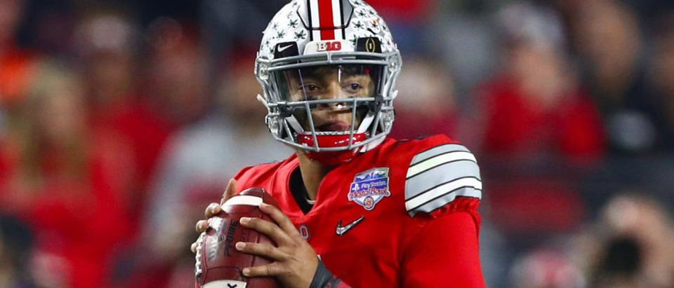 Dec. 28, 2019; Glendale, Arizona, USA; Ohio State Buckeyes quarterback Justin Fields (1) throws in the pocket against the Clemson Tigers in the 2019 Fiesta Bowl college football playoff semifinal game. Mandatory Credit: Matthew Emmons-USA TODAY Sports - via Reuters
