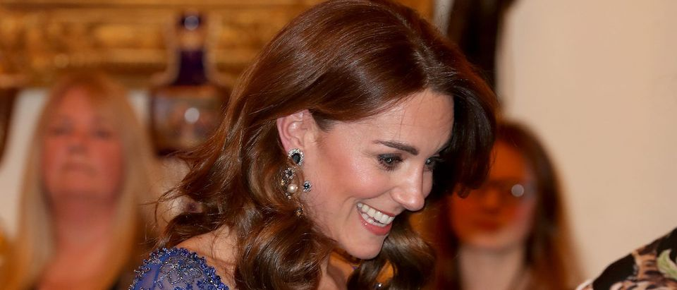 Catherine, Duchess of Cambridge, speaks with a school choir as she hosts a Gala Dinner in celebration of the 25th anniversary of Place2Be at Buckingham Palace, in London, Britain March 9, 2020. Chris Jackson/Pool via REUTERS