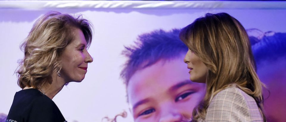 National PTA's president, Leslie Boggs (L) welcomes First Lady Melania Trump onstage at the 2020 National Parent Teacher Association (PTA) Legislative Conference at the Westin Alexandria Old Town on March 10, 2020 in Alexandria, Virginia. (Photo by OLIVIER DOULIERY/AFP via Getty Images)
