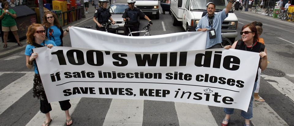 Activists protest Canadian government's closure of safe injection site, in Toronto