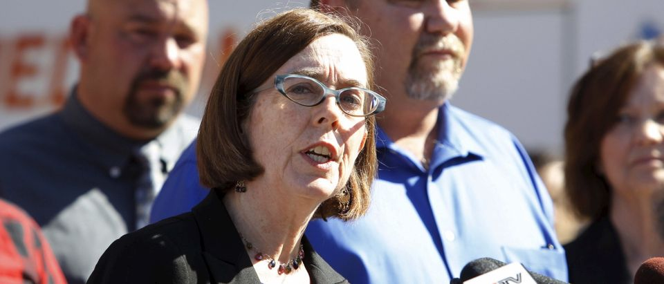 Oregon Governor Kate Brown speaks at news conference following a mass shooting at Umpqua Community College in Roseburg Oregon