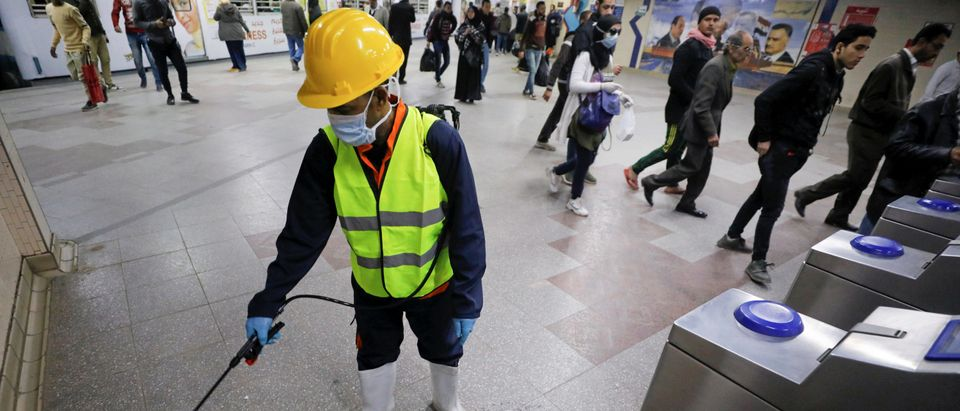 "A member of medical team sprays disinfectant at the Al Shohadaa ""Martyrs"" metro station in Cairo"