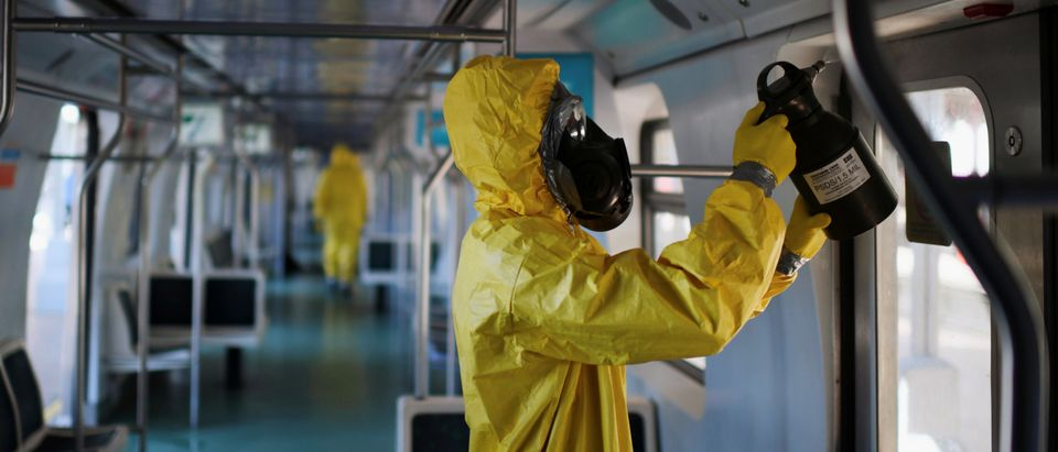 A member of the armed forces disinfects a train car during the coronavirus disease (COVID-19) outbreak, at the Brazil's Central station in Rio de Janeiro
