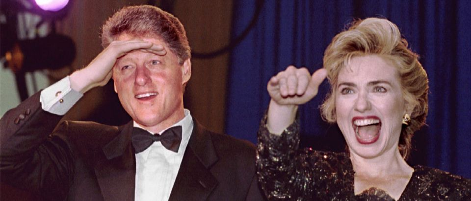 President - elect Bill Clinton and his wife Hillary look and wave at the crowd as they arrive to att..