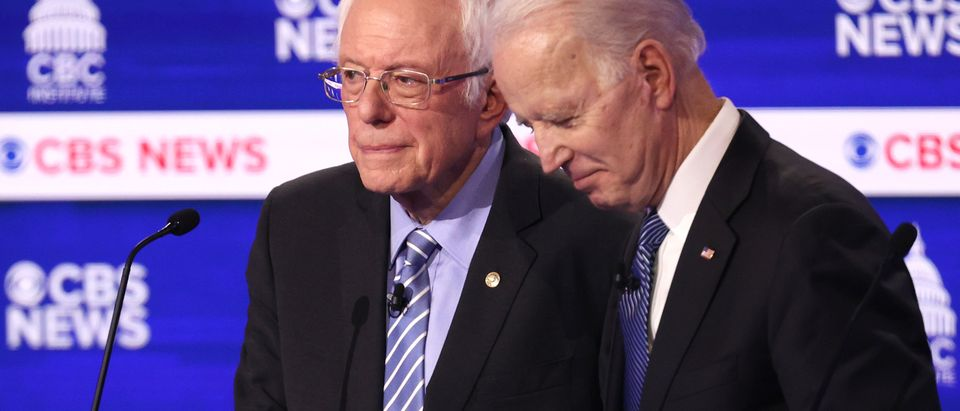 CHARLESTON, SOUTH CAROLINA - FEBRUARY 25: Democratic presidential candidates Sen. Bernie Sanders (I-VT) and former Vice President Joe Biden speak during a break at the Democratic presidential primary debate at the Charleston Gaillard Center on February 25, 2020 in Charleston, South Carolina. Seven candidates qualified for the debate, hosted by CBS News and Congressional Black Caucus Institute, ahead of South Carolina's primary in four days. (Photo by Win McNamee/Getty Images)
