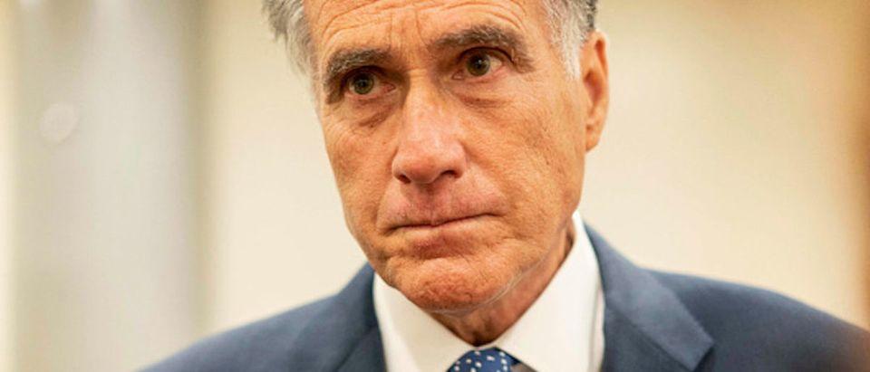 Senator Mitt Romney (R-UT) speaks to journalists before votes on the Senate floor on Capitol Hill in Washington