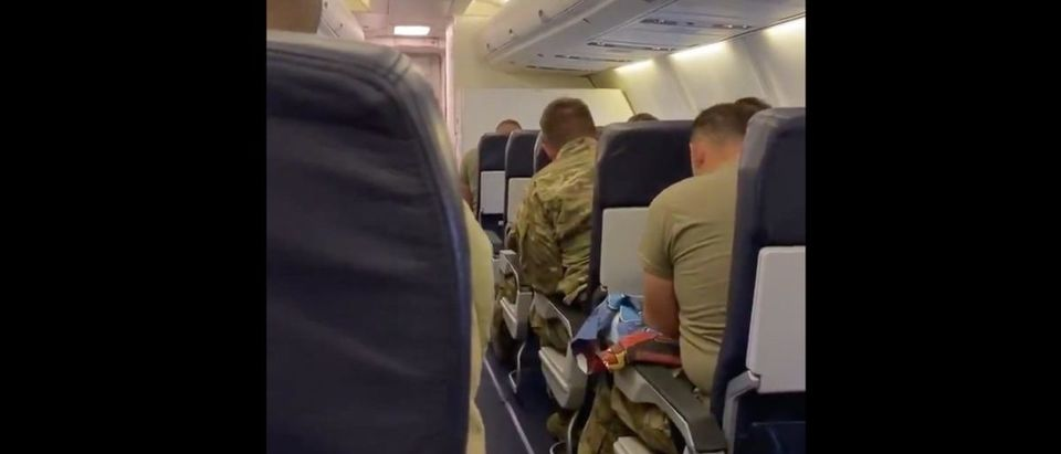 Soldiers Sing Country Roads (Credit: Screenshot/Twitter Video https://twitter.com/barstoolsports/status/1236409101913067522)