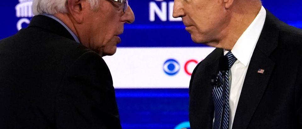 Democratic 2020 U.S. presidential candidates Senator Bernie Sanders and former Vice President Joe Biden talk at the tenth Democratic 2020 presidential debate at the Gaillard Center in Charleston