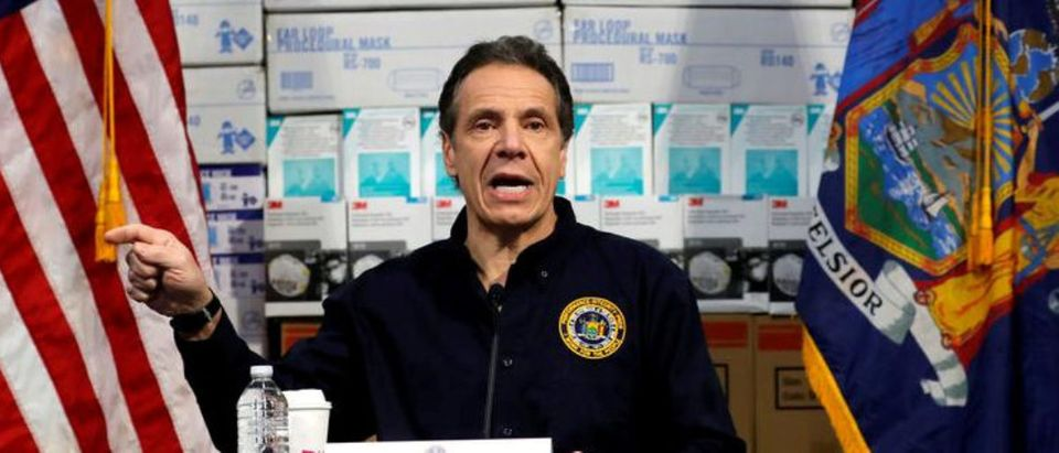 New York Governor Andrew Cuomo speaks in front of stacks of medical protective supplies during a news conference at the Jacob K. Javits Convention Center which will be partially converted into a temporary hospital during the outbreak of the coronavirus disease (COVID-19) in New York City, New York, U.S., March 24, 2020. REUTERS/Mike Segar/File Photo