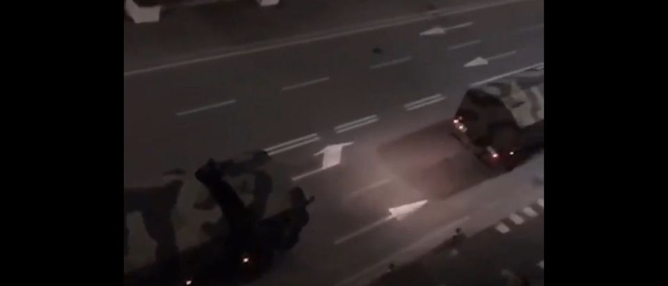Footage shows Italian military trucks transporting bodies. (Screenshot/Twitter/BloombergQuicktake)