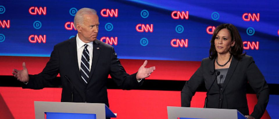 Democratic presidential candidate former Vice President Joe Biden (L) speaks while Sen. Kamala Harris (D-CA) listens during the Democratic Presidential Debate at the Fox Theatre July 31, 2019 in Detroit, Michigan