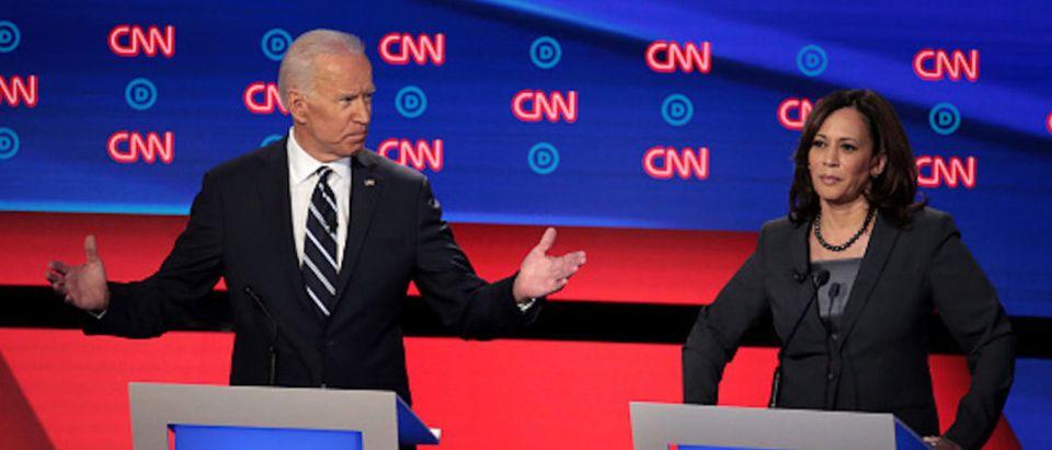 Democratic presidential candidate former Vice President Joe Biden (L) speaks while Sen. Kamala Harris (D-CA) listens during the Democratic Presidential Debate at the Fox Theatre July 31, 2019 in Detroit, Michigan
