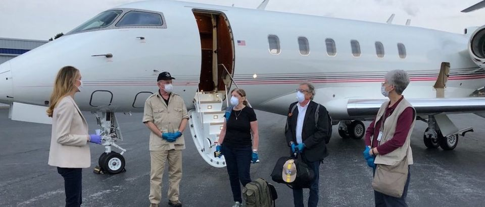 Four passengers on Sen. Loeffler's jet. She picked them up as they were stranded on a Florida cruise ship. (Photo Credit: Loeffler's office)