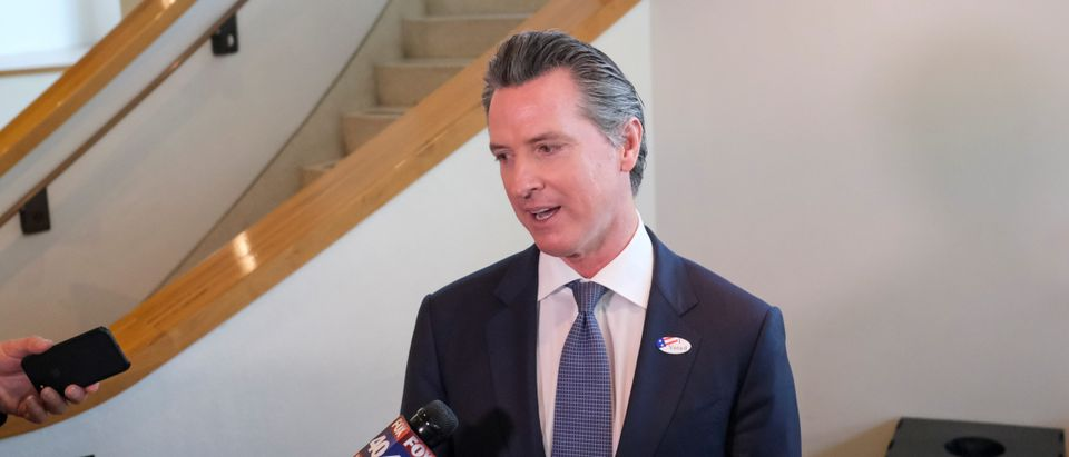 California's Governor Gavin Newsom speaks to the media after casting his vote at a voting center at The California Museum for the presidential primaries on Super Tuesday in Sacramento