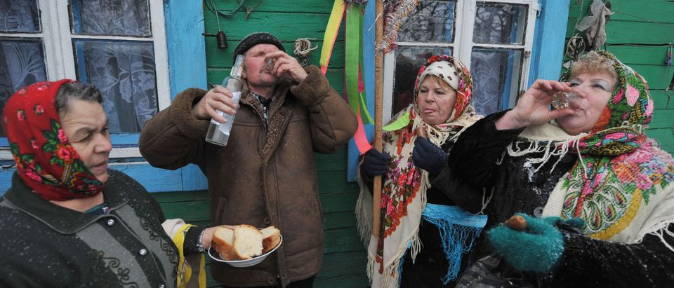 Residents drink vodka during traditional