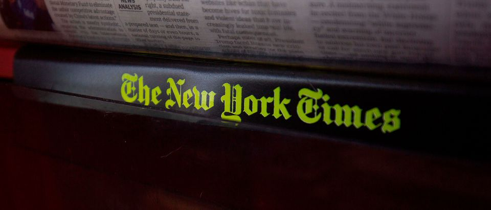 The New York Times logo is seen on a newspaper rack at a convenience store in Washington, DC, on August 6, 2019. (ALASTAIR PIKE/AFP via Getty Images)