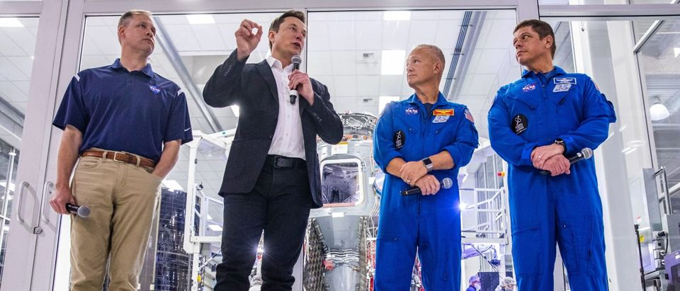 SpaceX founder Elon Musk (2nd L) addresses the media alongside NASA Administrator Jim Bridenstine (L), and astronauts Doug Hurley (2nd R) and Bob Behnken (R), during a press conference announcing new developments of the Crew Dragon reusable spacecraft, at SpaceX headquarters in Hawthorne, California on October 10, 2019. (Photo by PHILIP PACHECO/AFP via Getty Images)