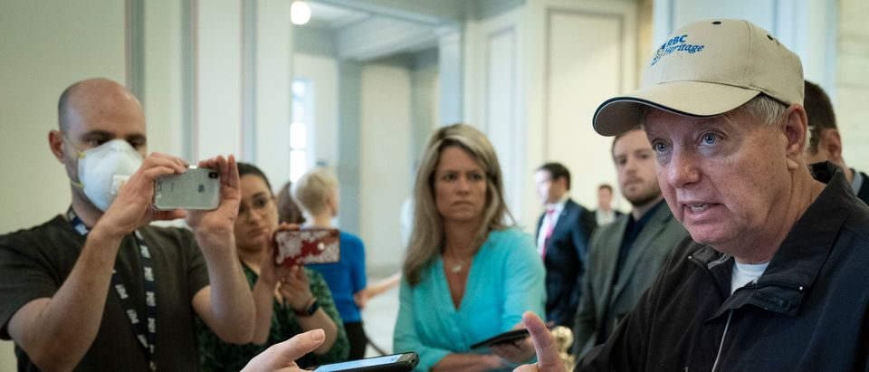 Sen. Lindsey Graham (R-SC) talks with reporters before a Senate GOP lunch meeting in the Russell Senate Office Building on Capitol Hill March 20, 2020 in Washington, DC. (Drew Angerer/Getty Images)