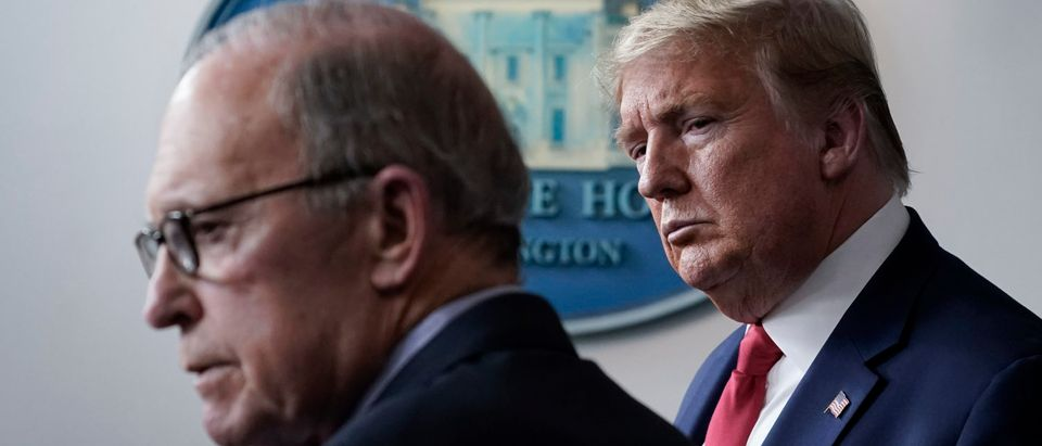 WASHINGTON, DC - MARCH 24: (L-R) Director of the National Economic Council Larry Kudlow speaks as U.S. President Donald Trump looks on during a briefing on the coronavirus pandemic, in the press briefing room of the White House on March 24, 2020 in Washington, DC. Cases of COVID-19 continue to rise in the United States, with New York's case count doubling every three days according to Governor Andrew Cuomo. (Photo by Drew Angerer/Getty Images)