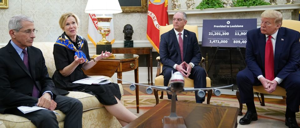 Dr. Anthony Fauci (L), director of the National Institute of Allergy and Infectious Diseases listens as Response coordinator for White House Coronavirus Task Force Deborah Birx speaks, during a meeting with US President Donald Trump and Louisiana Governor John Bel Edwards(C)D-LA in the Oval Office of the White House in Washington, DC on April 29, 2020. (Photo by MANDEL NGAN/AFP via Getty Images)