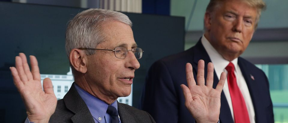 WASHINGTON, DC - APRIL 13: Dr. Anthony Fauci, director of the National Institute of Allergy and Infectious Diseases speaks as President Donald Trump listens during the daily briefing of the White House Coronavirus Task Force at the James Brady Press Briefing Room of the White House April 13, 2020 in Washington, DC. On Monday President Trump tweeted that he will be the one to make the decision to re-open the states in conjunction with the Governors and input from others. (Photo by Alex Wong/Getty Images)
