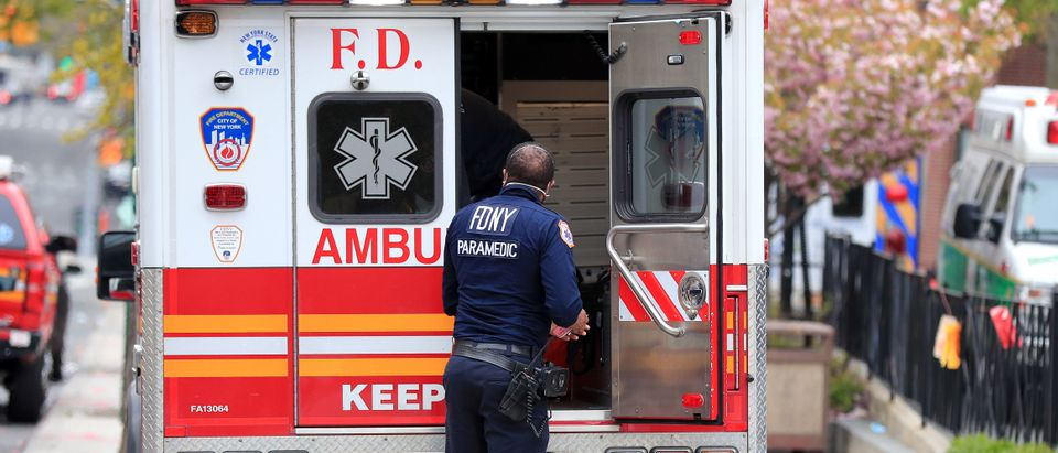 A FDNY paramedic unloads a patient from an ambulance near the Emergency Room entrance to the Brooklyn Hospital Center on April 23, 2020 in the Clinton Hill neighborhood of the Brooklyn borough of New York City. (Mike Lawrie/Getty Images)
