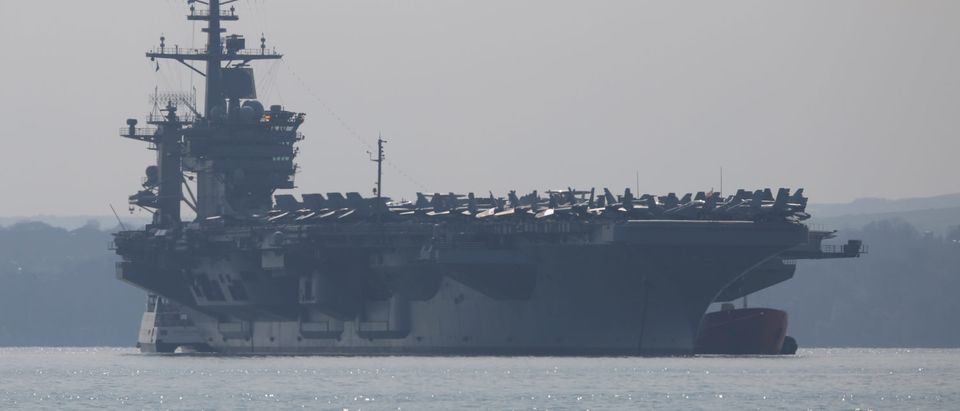 The USS Theodore Roosevelt anchors off the coast on March 23, 2015 in Gosport, England. The 1,092ft-long US Aircraft carrier is currently stationed off Stokes Bay in Gosport on a five day visit before continuing on it's round-the-world deployment. (Dan Kitwood/Getty Images)