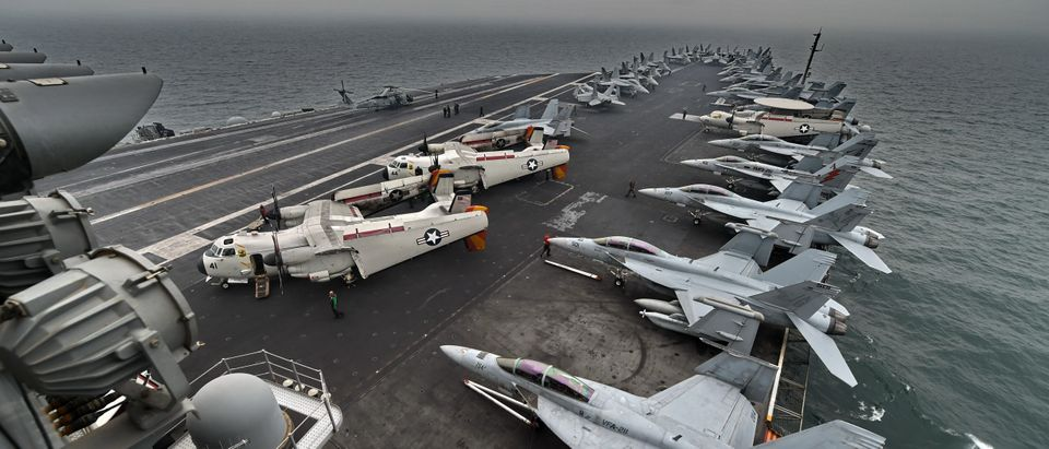 A general view shows the flight deck on board the aircraft carrier USS Theodore Roosevelt (CVN 71) as the vessel sails towards the Straits of Malacca heading to Singapore on October 23, 2015. (ROSLAN RAHMAN/AFP via Getty Images)