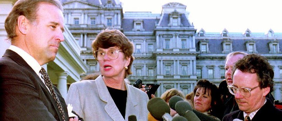 U.S. Attorney General Janet Reno (C), turns to ans