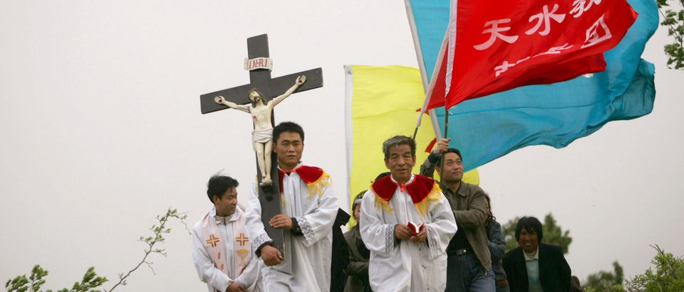 Chinese Catholics Pray At Holy Place, Cross Hill
