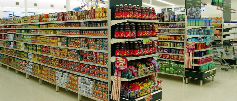 Various canned food and produce on the shelves at