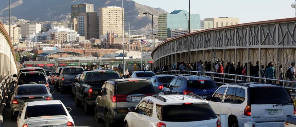 Drivers and commuters wait in line to cross to El Paso, Texas, on the international border crossing bridge Paso del Norte, in Ciudad Juarez