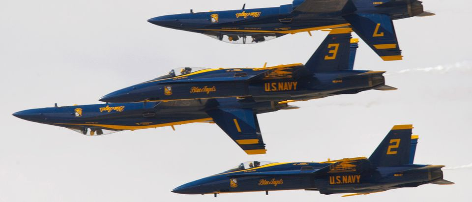 U.S. Navy Flight Demonstration Squadron, the Blue Angels, fly in tight formation as they practice routines in F/A-18 Hornet fighter jets on rehearsal day for the Los Angeles County Air Show in Lancaster