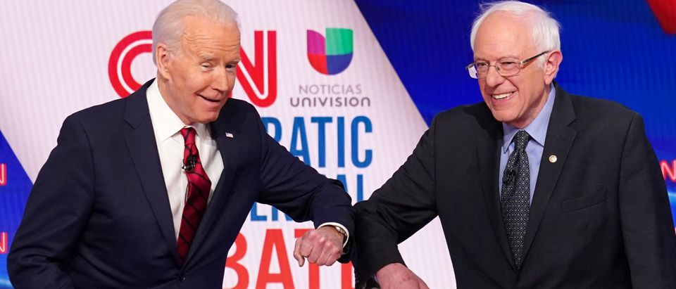 FILE PHOTO: Democratic U.S. presidential candidates Senator Bernie Sanders and former Vice President Joe Biden at the 11th Democratic candidates debate of the 2020 U.S. presidential campaign in Washington