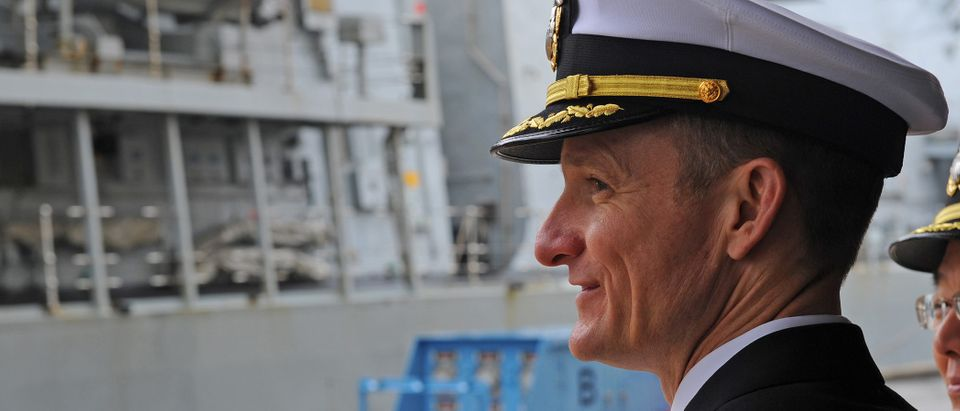 Captain Brett E. Crozier watches Royal Navy HMS Sutherland as she arrives in Yokosuka