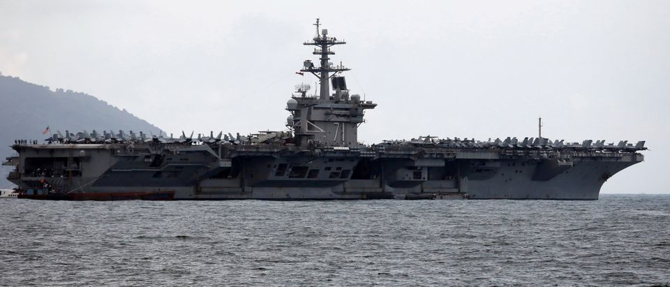 The USS Theodore Roosevelt (CVN-71) is seen while entering into the port in Da Nang, Vietnam, March 5, 2020. (REUTERS/Kham/File Photo - RC23ZF9KW2AQ)