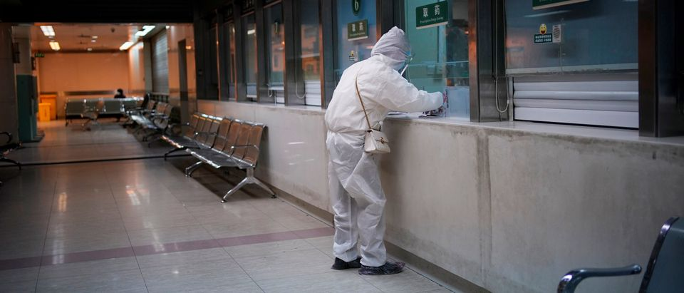 A woman wearing protective suit is seen at a hospital after the lockdown was lifted in Wuhan