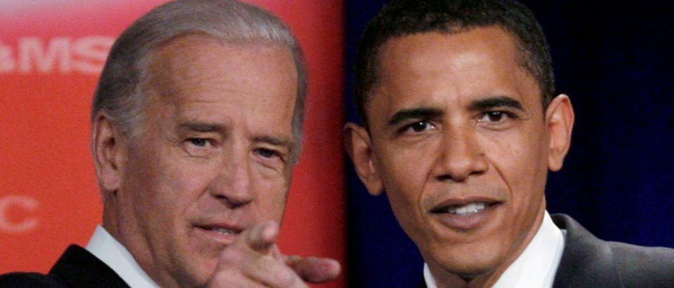 FILE PHOTO: Democratic presidential candidates Biden and Obama talk prior to presidential debate in Orangeburg, South Carolina