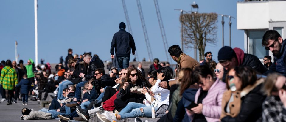 People enjoy the sun, as the spread of the coronavirus disease (COVID-19) continues, in Malmo, Sweden April 5, 2020. TT News Agency/Johan Nilsson via REUTERS ATTENTION EDITORS - THIS IMAGE WAS PROVIDED BY A THIRD PARTY. SWEDEN OUT. NO COMMERCIAL OR EDITORIAL SALES IN SWEDEN.