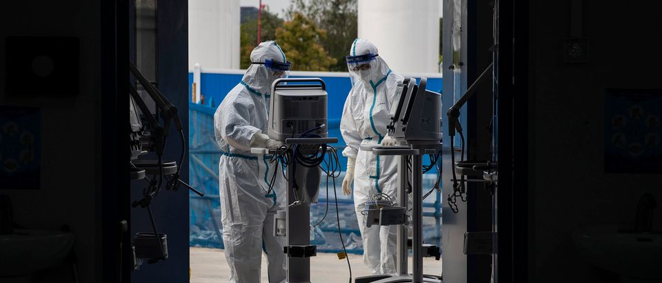 This photo taken on April 14, 2020 shows staff members transferring medical equipment after all patients left Leishenshan Hospital in Wuhan in China's central Hubei province. - The Leishenshan hospital, built in less than two weeks and handled a large number of patients infected with the COVID-19 coronavirus closed on April 14, after transferring its last four patients to another hospital. (Photo by STR / AFP) / China OUT (Photo by STR/AFP via Getty Images)
