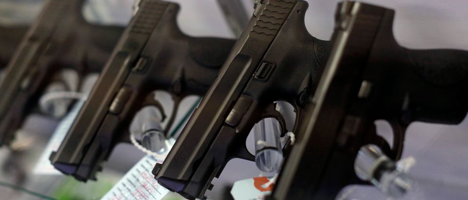 Handguns are seen for sale in a display case at Metro Shooting Supplies in Bridgeton, Missouri, November 13, 2014. The store has reported an increase in gun sales as the area waits for a grand jury to reach a decision this month on whether to indict Darren Wilson, the white police officer who shot and killed the 18-year-old Mike Brown, who was black, on Aug. 9 in the St. Louis suburb of Ferguson. REUTERS/Jim Young