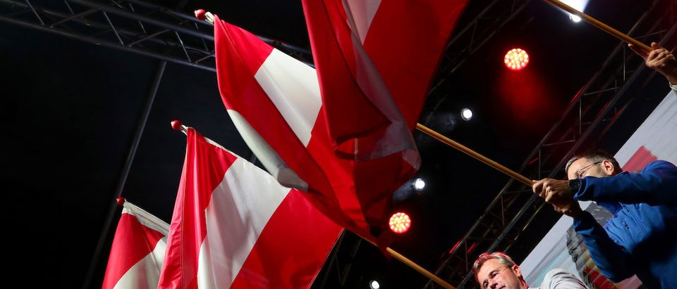 Vice Mayor of Vienna Dominik Nepp, Head of Austria's Freedom Party Norbert Hofer and Former Interior Minister Herbert Kickl wave Austrian flags during the final election rally in Vienna, Austria, September 27, 2019. REUTERS/Lisi Niesner