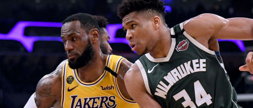 LOS ANGELES, CALIFORNIA - MARCH 06: Giannis Antetokounmpo #34 of the Milwaukee Bucks attempts to get open as LeBron James #23 of the Los Angeles Lakers defends during the third quarter at Staples Center on March 06, 2020 in Los Angeles, California. (Photo by Harry How/Getty Images)
