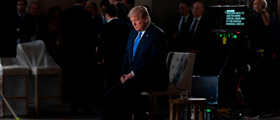 """US President Donald Trump gestures during a commercial break of a Fox News virtual town hall """"America Together: Returning to Work,"""" event from the Lincoln Memorial in Washington, DC on May 3, 2020. - Trump will answer questions submitted by viewers on Twitter, Facebook and Instagram (Photo by JIM WATSON/AFP via Getty Images)"""