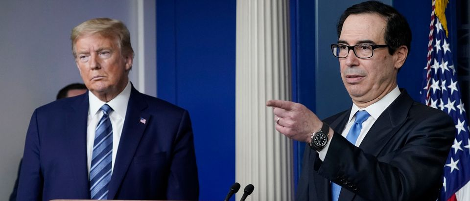 WASHINGTON, DC - APRIL 21: Treasury Secretary Steven Mnuchin speaks as U.S. President Donald Trump looks on during the daily coronavirus task force briefing at the White House on April 21, 2020 in Washington, DC. Earlier in the day, the president met with New York Gov. Andrew Cuomo in the Oval Office to discuss COVID-19 testing. (Photo by Drew Angerer/Getty Images)